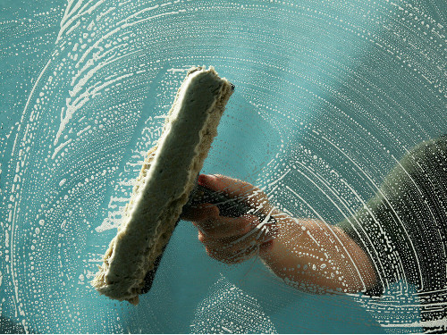 window cleaning squeegee on glass